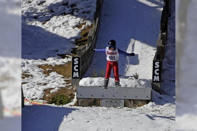 Junge Meister auf Skiern