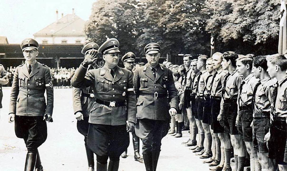 Lörrachs Bürgermeister Reinhard Boos (...n Schirach, der 1937 Lörrach besuchte.  | Foto: BZ