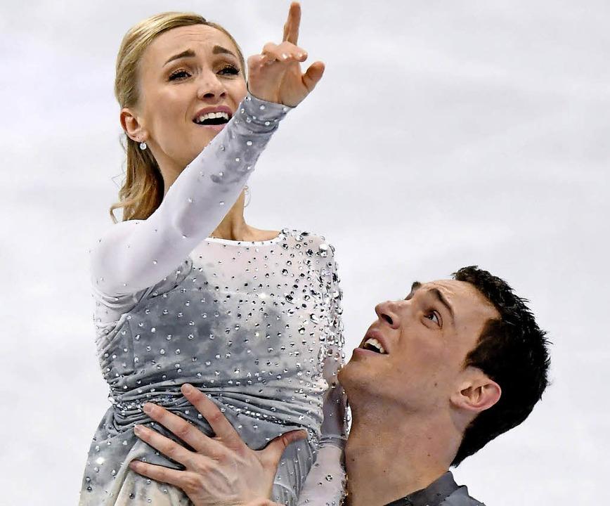 Ausdrucksstark: Aliona Savchenko und Bruno Massot  | Foto: dpa