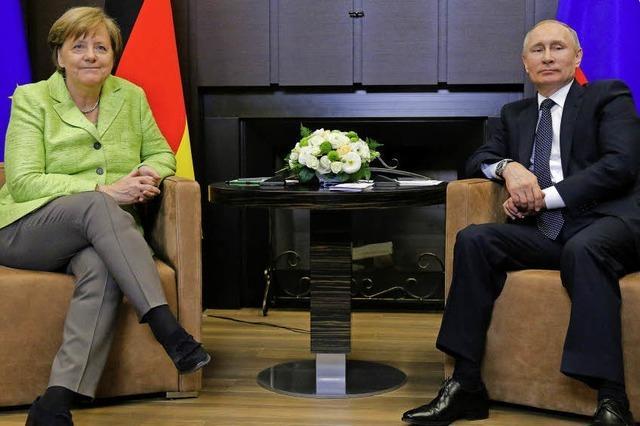 Mühsame Gespräche: Merkel und Putin treffen sich in Sotschi