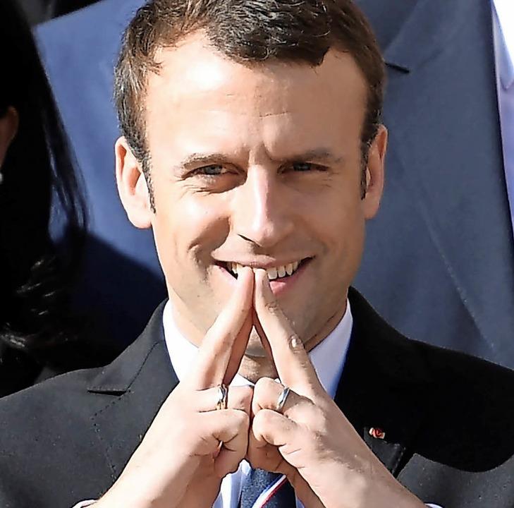 Geste für die Olympia-Bewerbung:  Frankreichs neuer Staatspräsident Macron    | Foto: AFP