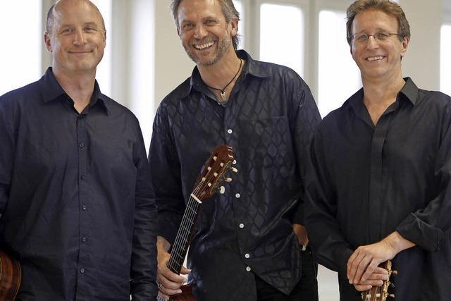 Drei Gitarren erklingen