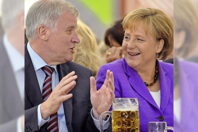 Seehofer und Merkel demonstrieren Einigkeit in München
