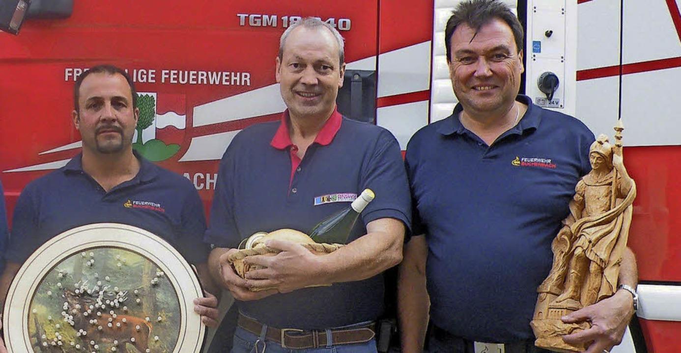 Nahmen die Siegertrophäen in Empfang (...chenbacher   Kommandant Florian Döll.   | Foto: Privat