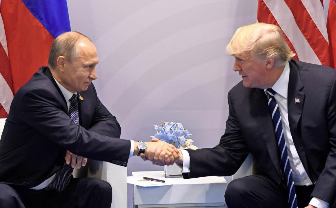 Händedruck zwischen Alphamännern: Putin und Trump in Hamburg.    Foto: AFP
