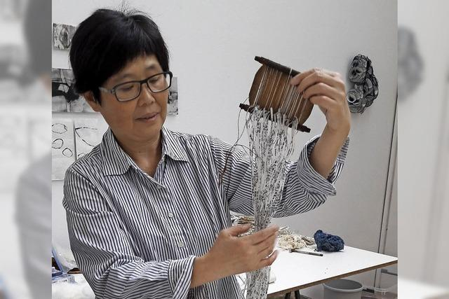Kunst aus Papier und Textilien