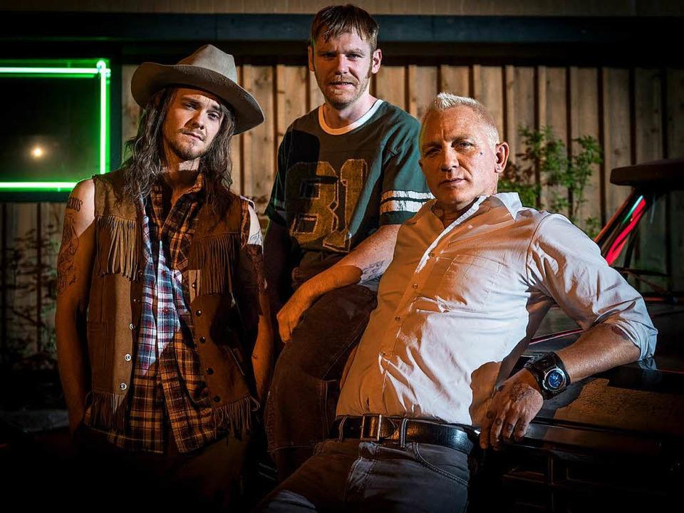Fish Bang (Jack Quaid), Sam Bang (Brian Gleeson) und Joe Bang (Daniel Craig)   | Foto: dpa