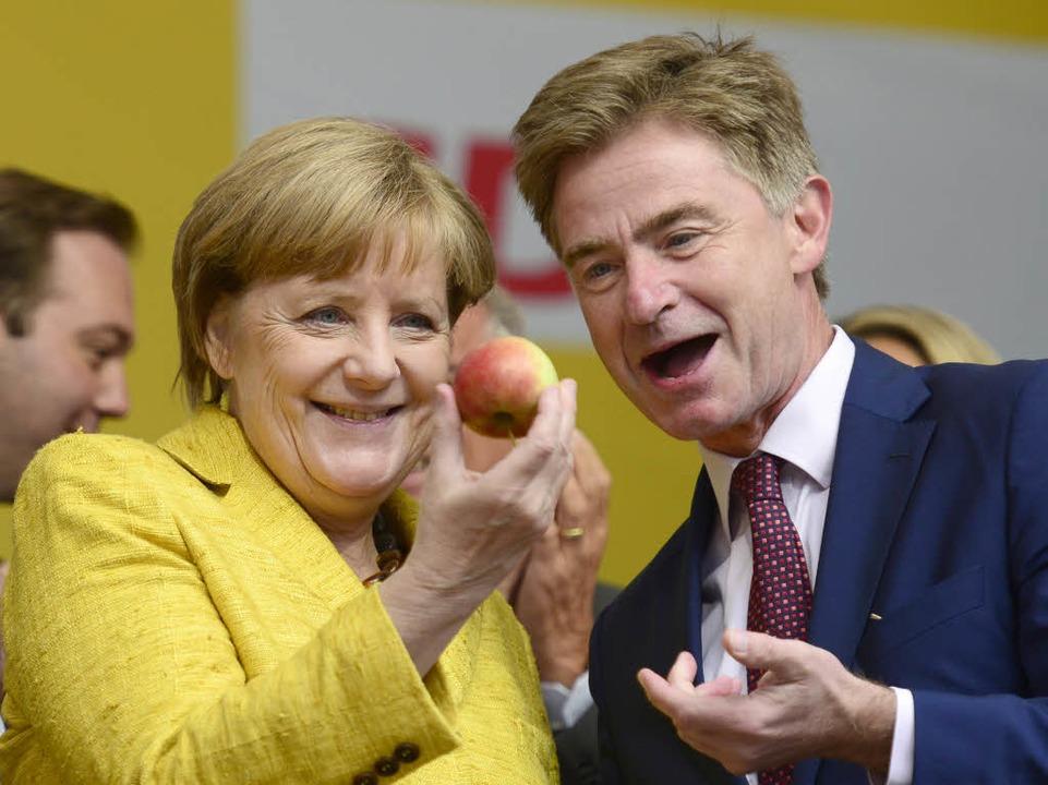 Matern von Marschall am 18. September mit Kanzlerin Merkel.  | Foto: Ingo Schneider
