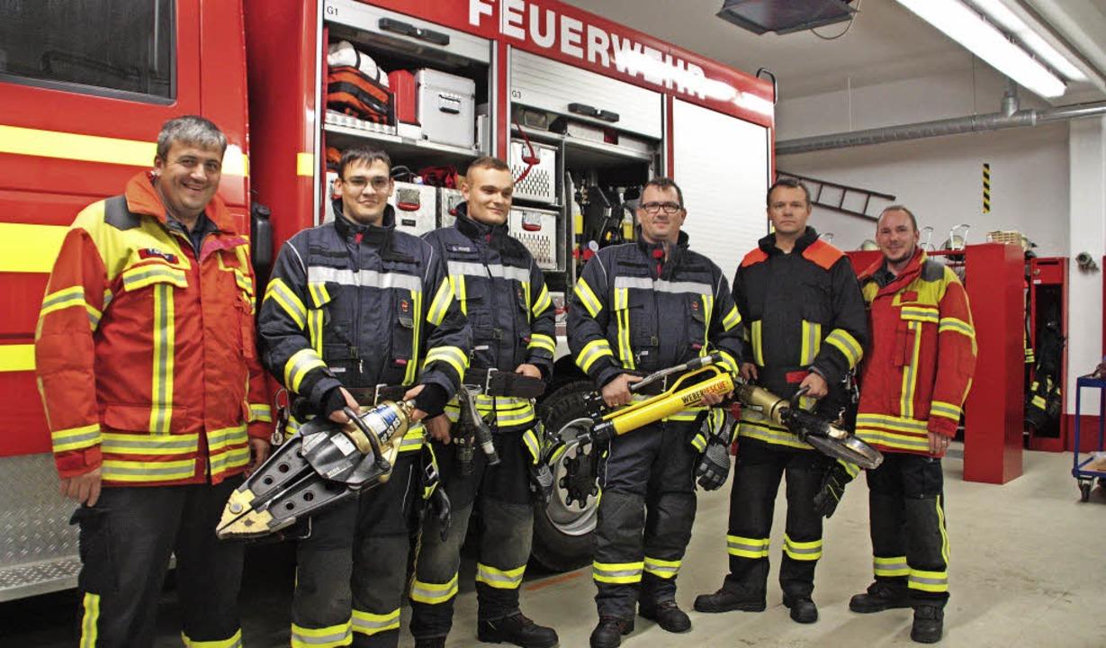 Abteilungskommandant Thorsten Griener ... Maike, Markus Jost und Enrico Helbig   | Foto: Jörn Kerckhoff