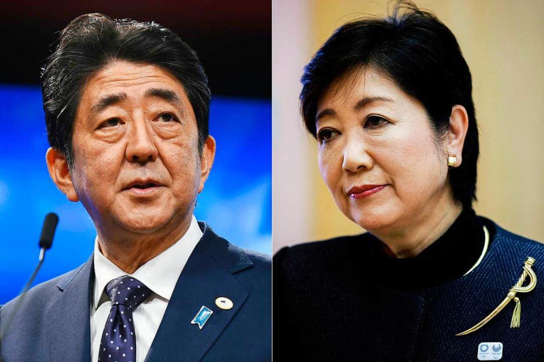 Japans Premierminister Shinzo Abe und seine Herausforderin Yuriko Koike.  | Foto: AFP