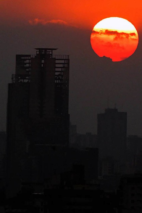 """Das Hochaus """"Torre de David&#822...aus dem höchsten Slum der Welt weichen    Foto: AFP"""