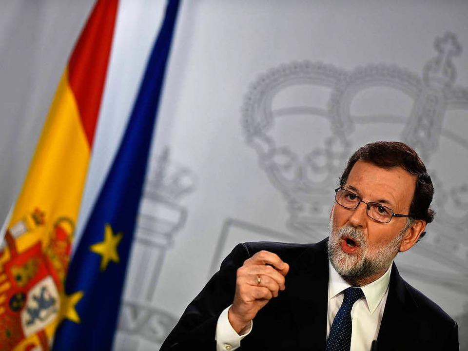 Spaniens Ministerpräsident Rajoy macht...en Sezessionsbemühungen Abstand nimmt.    Foto: AFP