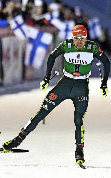 Johannes Rydzek skatet zum ersten Saisonsieg.     Foto: dpa