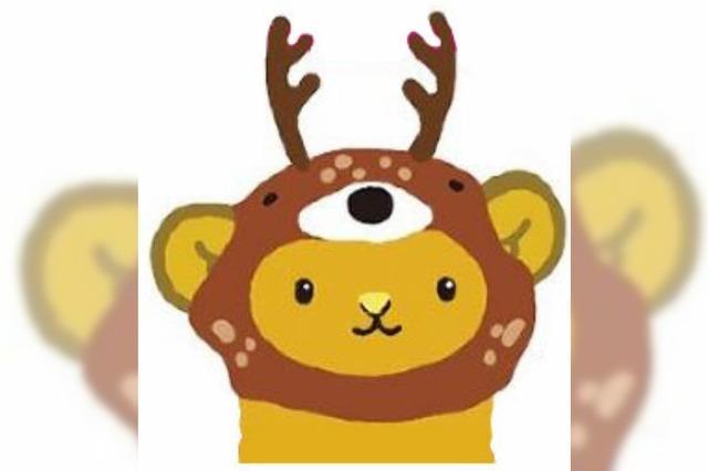 Ein Bär im Hirschkostüm soll in Japan vor Touristen am Steuer warnen