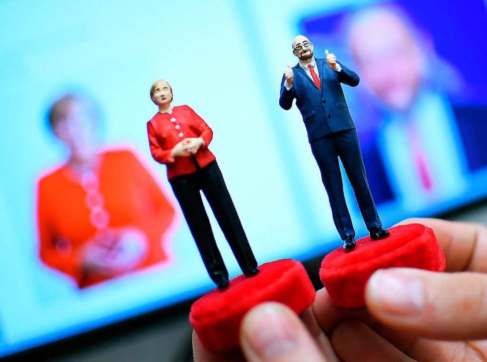 Kommen Merkel und Schulz zusammen? Ein... neuen großen Koalition kommen könnte.  | Foto: Britta Pedersen
