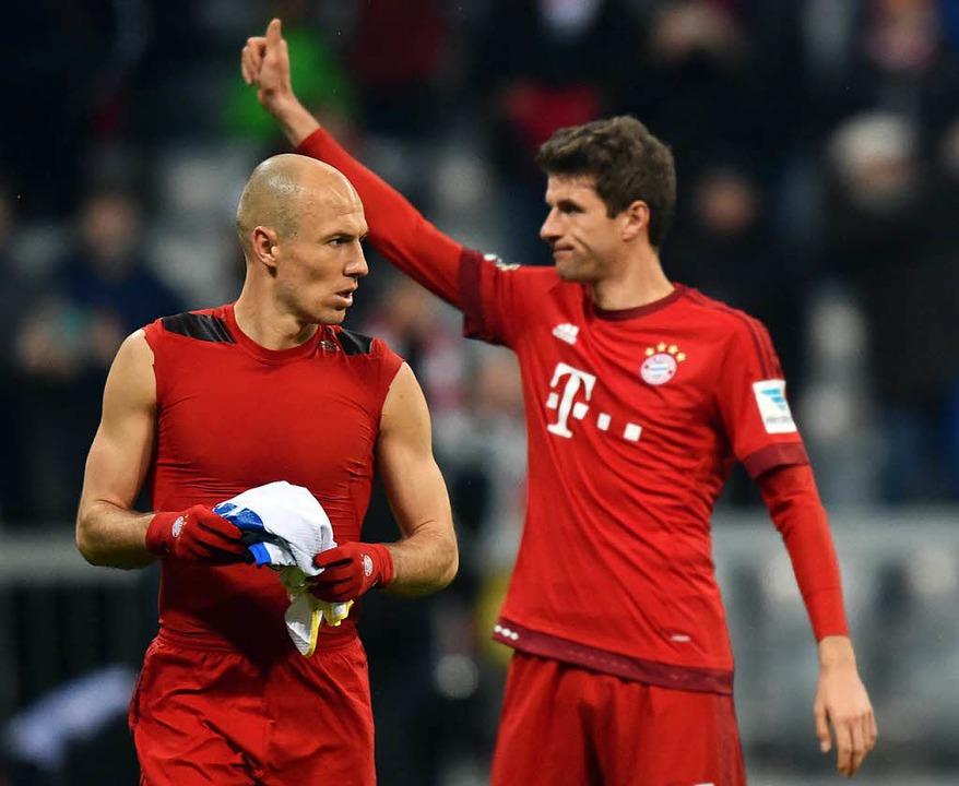 Arjen Robben (rechts: Thomas Müller)    Foto: dpa