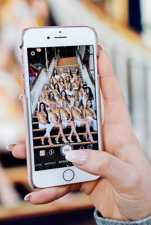 """Die Kandidatinnen zur Wahl der """"M...em Display eines Smartphones zu sehen.    Foto: dpa"""