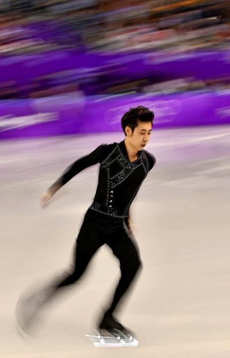 An den Erwartungen seiner Landsleute v...rt: Chinas  Eiskunstläufer Jin Boyang     Foto: AFP