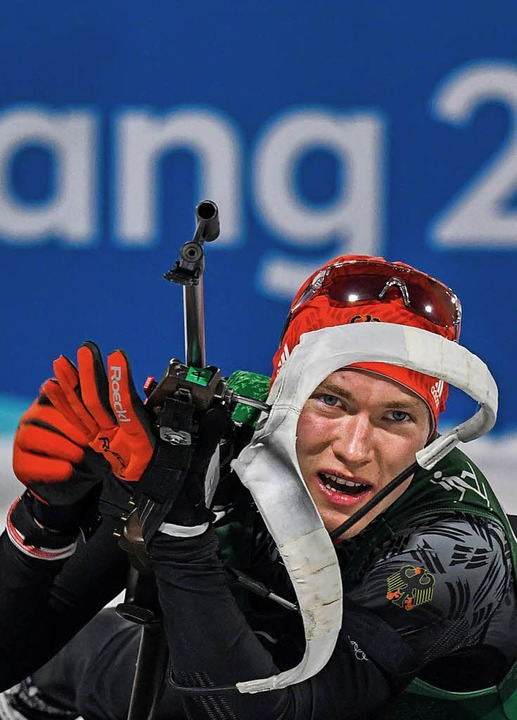 Benedikt Doll am Schießstand  | Foto: AFP
