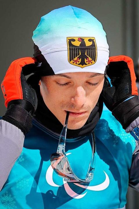Martin Fleig bereitet sich in  Pyeongchang aufs Training vor.  | Foto: dpa