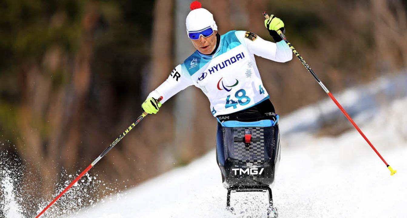 Andrea Eskau gewinnt Silber beim Langlauf über zwölf Kilometer.   | Foto: dpa
