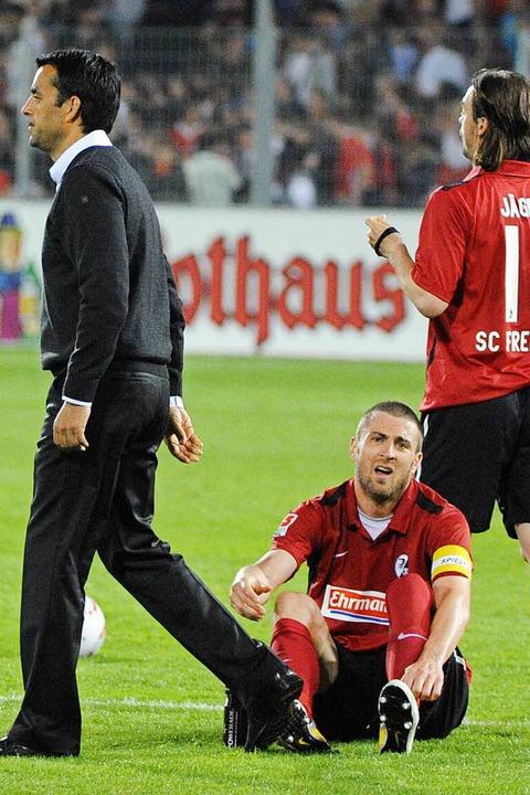 Dutt (l.) und der damalige SC-Kapitän ... Boden) im Jahr 2011 beim SC Freiburg.  | Foto: Achim Keller