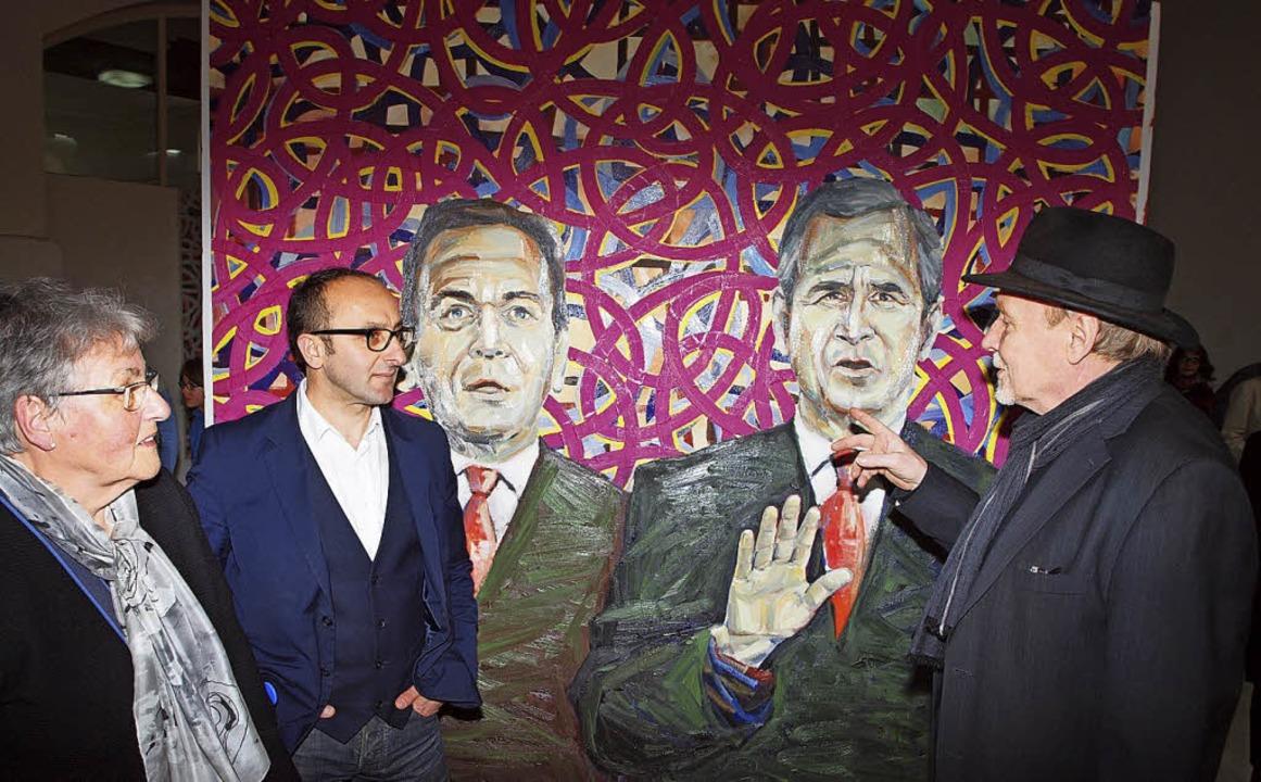 Gela Samsonidse und Galerist Thomas Me...die in der Ausstellung zu sehen sind.   | Foto: Michael Haberer
