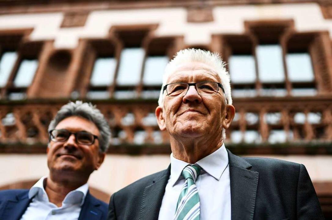 Der abgewählte Freiburger Oberbürgerme...und Parteifreund Winfried Kretschmann.  | Foto: dpa
