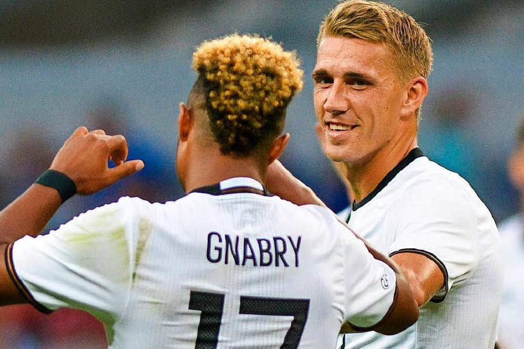 Während Serge Gnabry die WM verletzt v...ltrikot zu tragen, offenbar gestiegen.  | Foto: dpa
