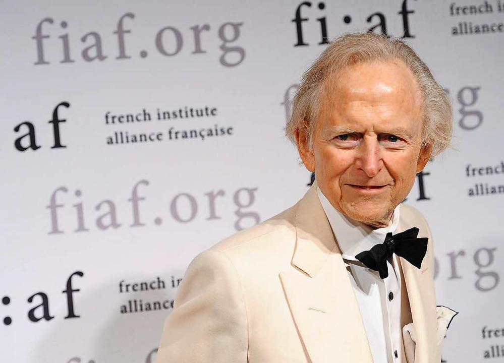 Markenzeichen weißer Anzug und Fliege: Tom Wolfe (2012)  | Foto: AFP