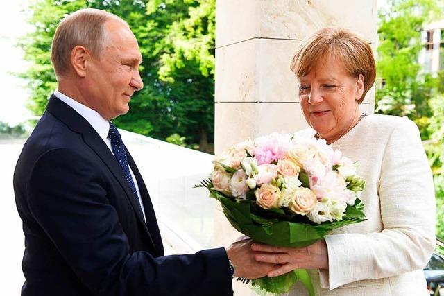 Vorsichtige Annäherung zwischen Merkel und Putin