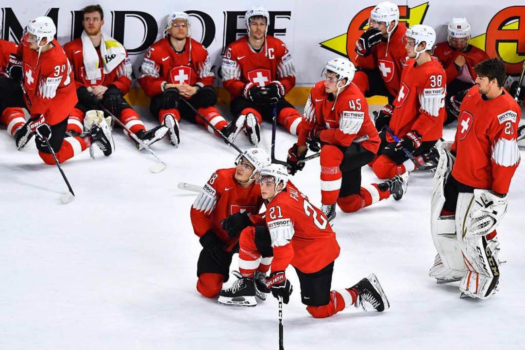 Enttäuscht: die Schweizer Equipe.    Foto: AFP