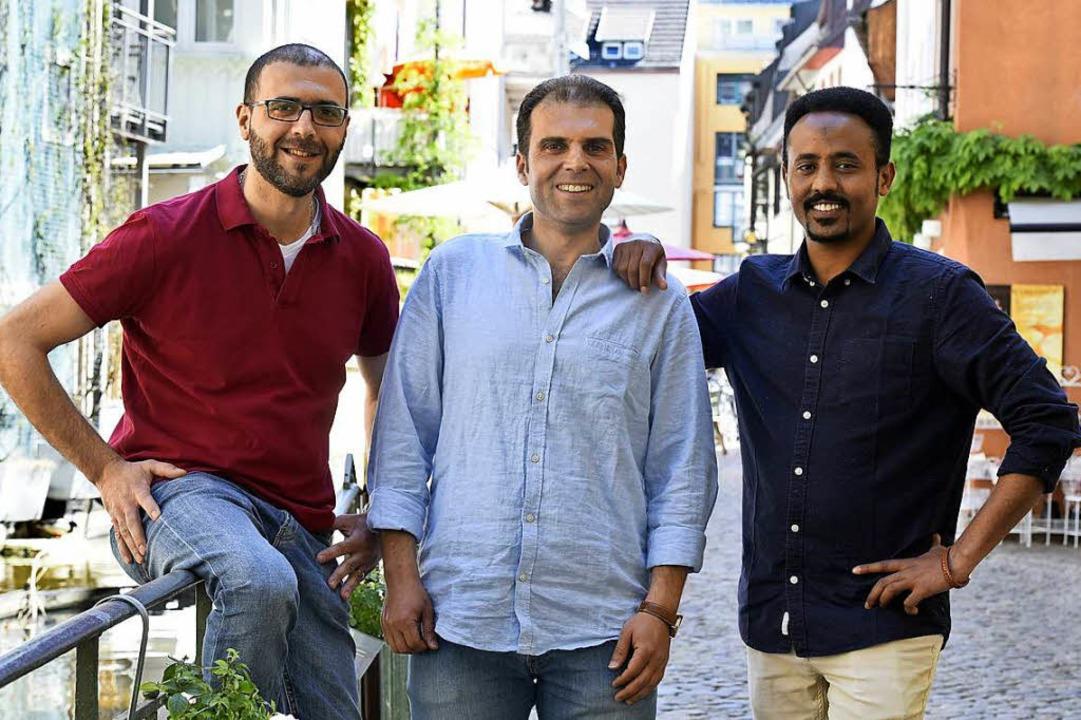 Angehende Unternehmer (von links): Eli...yrien, daneben Hamdi Salih aus Eritrea  | Foto: Thomas Kunz