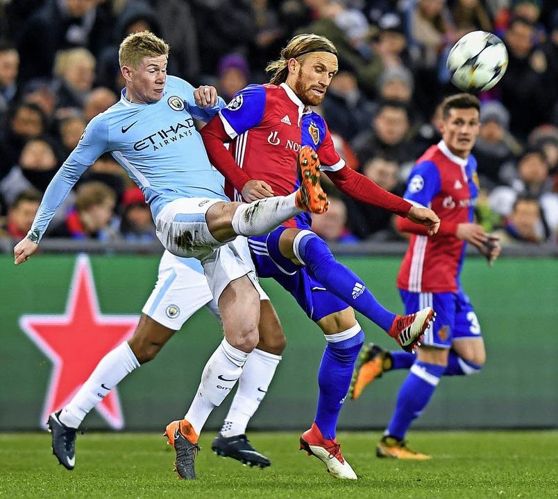 Sternstunden gab's fast nur in d... Kevin De Bruyne von Manchester City.   | Foto: Walter Bieri (dpa)/Oli SCARFF (AFP)