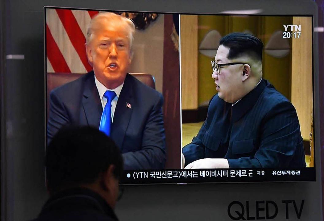 US-Präsident Donald Trump und Nordkore...m Jong Un im südkoreanischen Fernsehen  | Foto: AFP