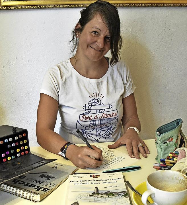 Zeichenstift, Farben und Skizzenblock ...zweisprachigen Comic im Kaffee gemacht  | Foto: Markus Zimmermann
