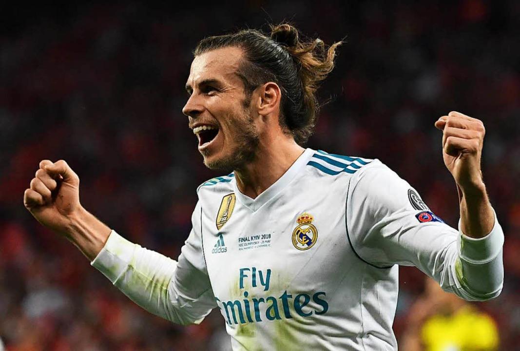 Gareth Bale bejubelt sein Tor zum 3:1.    Foto: dpa