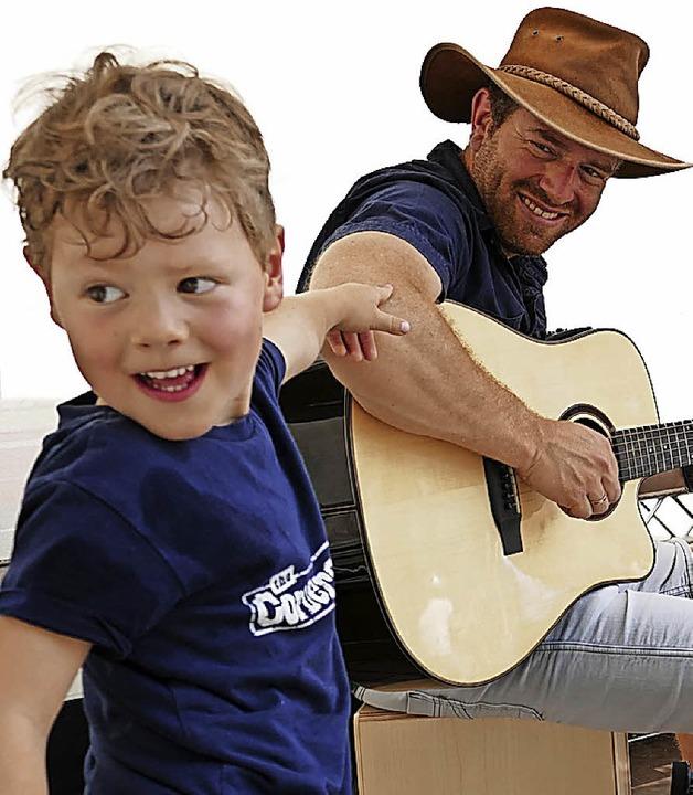 Schaut mal:  Papa spielt Gitarre.  | Foto: Hans-Peter Müller