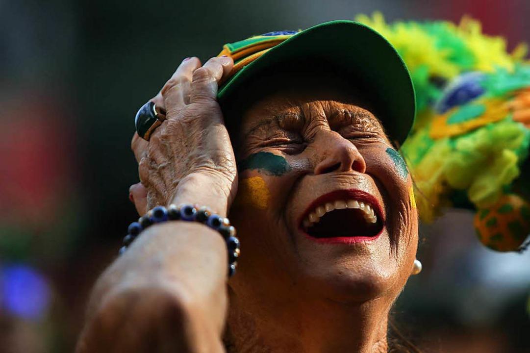 Ein weiblicher Fan der brasilianischen...er der Niederlage: Belgien siegte 2:1.  | Foto: dpa