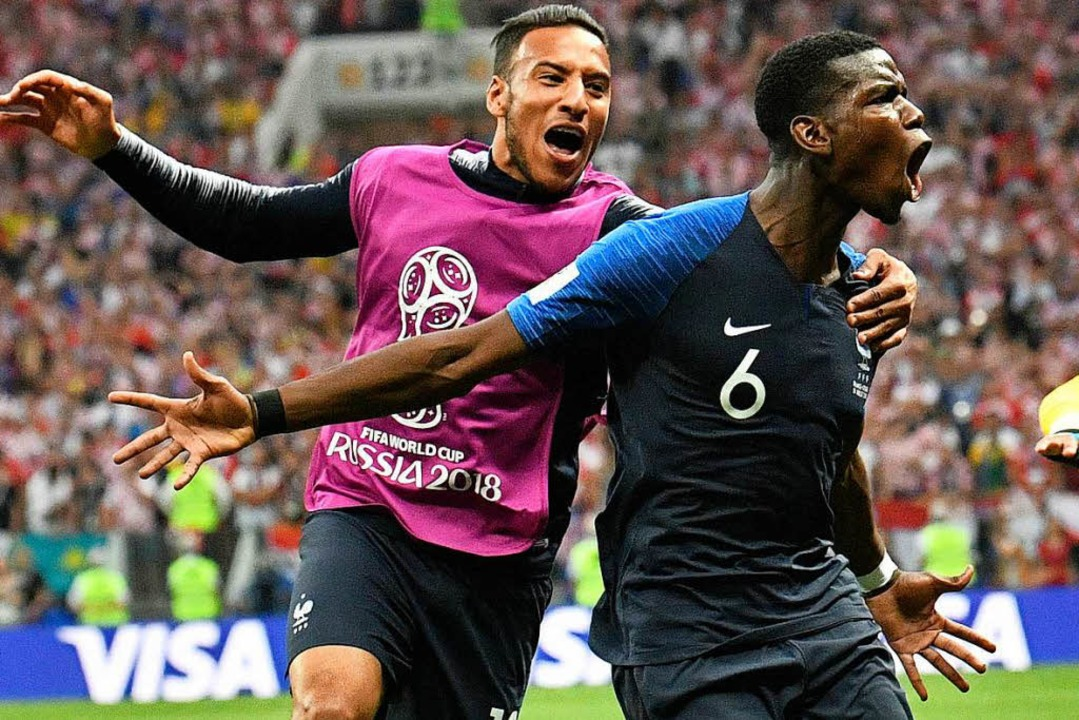 Paul Pogba aus Frankreich (r) bejubelt sein Tor zum 3:1. Foto:    Foto: dpa