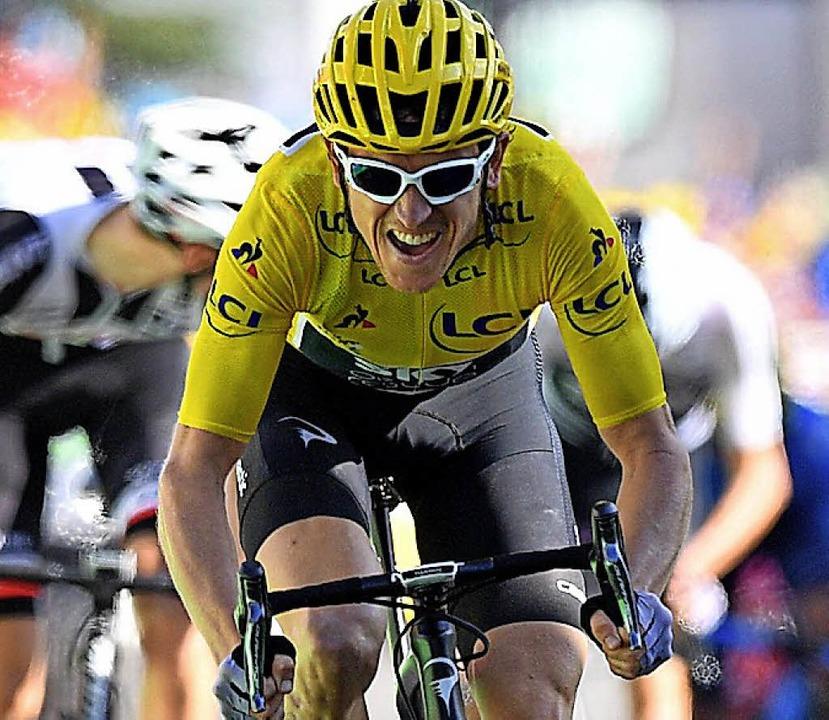 Als Erster auf dem Berg und weiter in Gelb: Geraint Thomas   | Foto: dpa