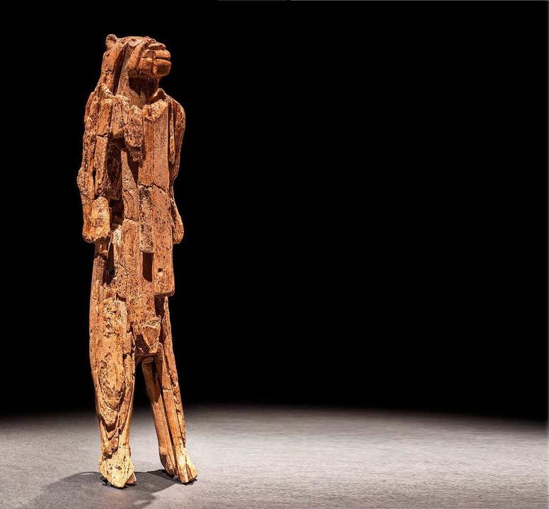 40000 Jahre alt: Löwenmensch aus  Mammutelfenbein, 31 Zentimeter hoch  | Foto: Oleg Kuchar - Museum Ulm