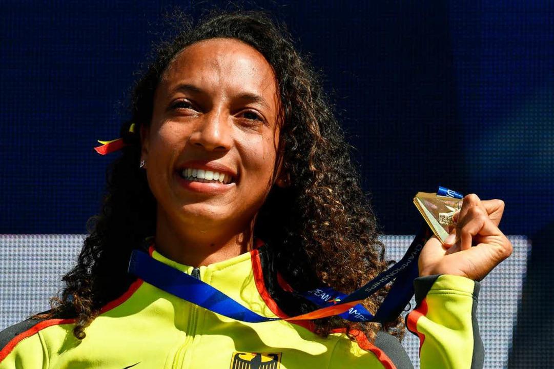 Lohn für jahrelanges hartes Training: Die Goldmedaille in Berlin  | Foto: AFP