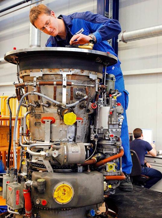 Wer als deutscher Maschinenbauer Servi...ng hoher bürokratischer Auflagen tun.   | Foto: DPA