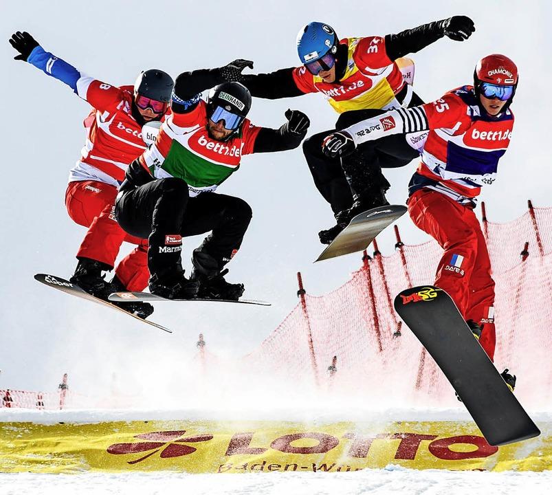 Rampensau: Wie hier beim Weltcup am Fe... die Snowboardcrosser ihre Arme aus.    | Foto: Seeger