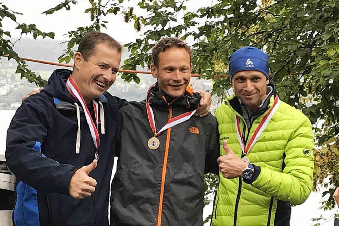 André Grabs (Mitte) belegte bei der Sc...Flossen am Zürichsee den ersten Platz.  | Foto: Birgit Standhartinger