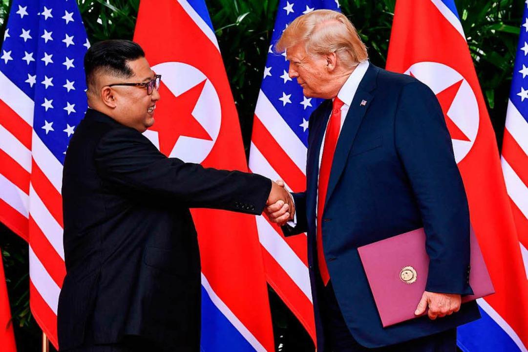 Im Juni jubelte US-Präsident Trump nac...eas Kim Jong-un über einen Durchbruch.  | Foto: AFP