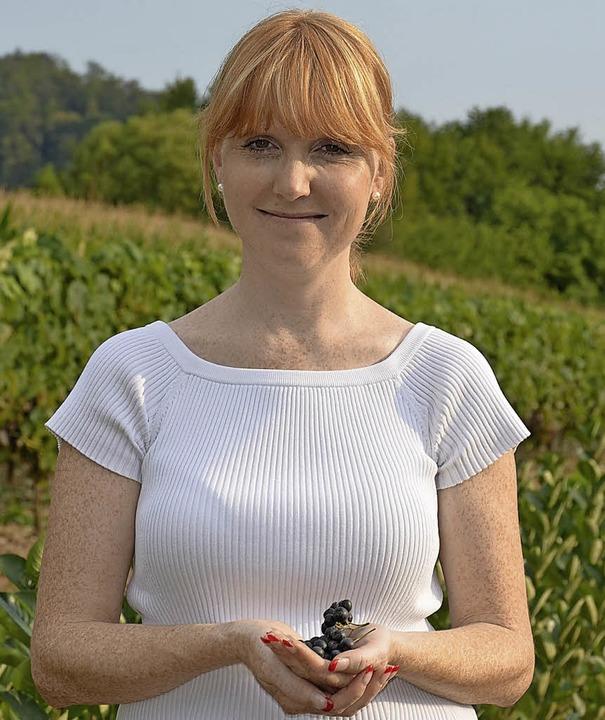Tanja Sommer mit frischen Aronia.  | Foto: Fotos: geh/tatiana/fotolia
