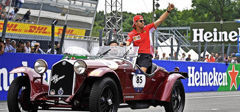 Die schönste Zeit beim Rennen in Monza...#8211; als er in einem Oldtimer saß.    | Foto: AFP
