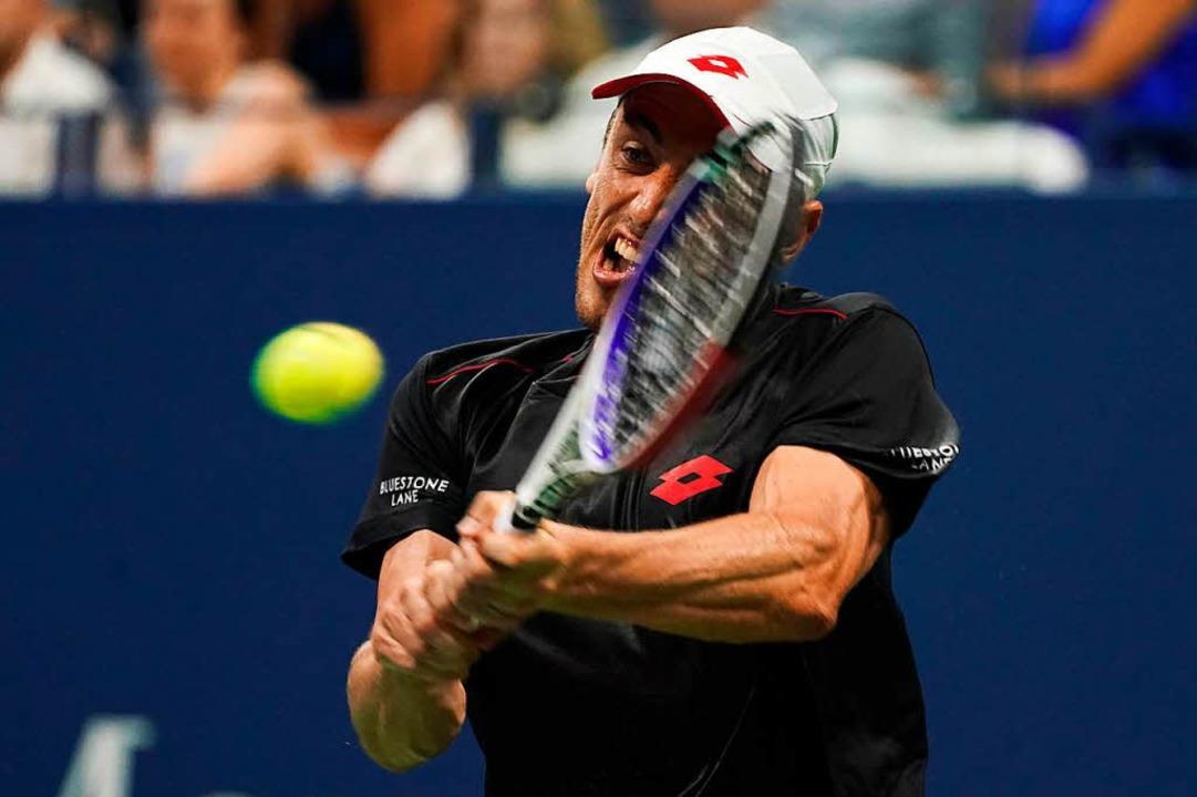 Der Australier John Millman schmiss Federer aus dem Match.  | Foto: AFP